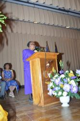 "Ida Partman Yearby ('67) at the memorial service giving an oration of the poem ""There Was A Man""."